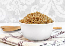 Cooked whole wheat quinoa in a bowl.  Macro with copy space. Stock Photography