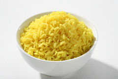 Cooked yellow rice in a bowl Royalty Free Stock Image