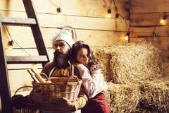 Cookee del cocinero y de la muchacha del cocinero imagenes de archivo