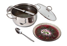 Cooker with beetroot cold  soup and plate of broth. Stock Photos