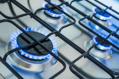 Cooker with blue gas flames Royalty Free Stock Photos