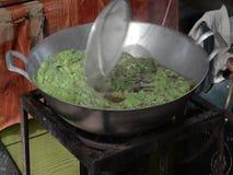 Frying crispy basil. Cooker is frying crispy basil - Thai side dish of street food stock video