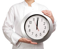 Cooker holding a clock Royalty Free Stock Photography