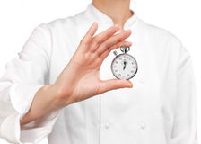 Cooker holding a stopwatch Royalty Free Stock Image