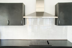 Cooker hood in kitchen room. At home Stock Photo