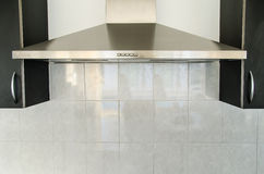 Cooker hood in kitchen room royalty free stock photos