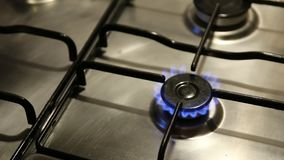 Natural gas stove with blue flame, gas methane. Slow motion stock footage