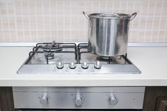 Cooker pot. Stainless steel cooking pot pan cooker hob Royalty Free Stock Photos