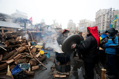 Cookers at street kitchen on a camp during anti-government protest in Kiev. KYIV, UKRAINE: Demonstrators cooking food at street kitchen on the crowded street Stock Photos