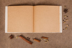Cookery book. With spices on brown parchment backgrownd royalty free stock photography