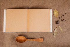 Cookery book. With spices on brown parchment backgrownd Royalty Free Stock Photos