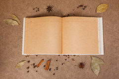 Cookery book. With spices on brown parchment backgrownd Stock Image