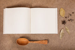 Cookery book. With spices on brown parchment backgrownd Royalty Free Stock Photo