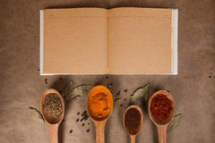 Cookery book. With spices on brown parchment backgrownd Stock Images