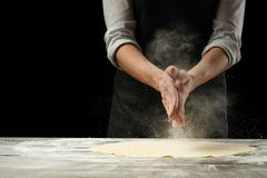 Cookery.Chef prepares dough for pasta, pizza, bread.Preparation and work with flour. Delicious food, recipes, cooking, gastronomy royalty free stock photo