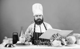 Cookery on my mind. Cooking skill. Book recipes. According to recipe. Man bearded chef cooking food. Check if you have. All ingredients. Cook read book recipes royalty free stock images