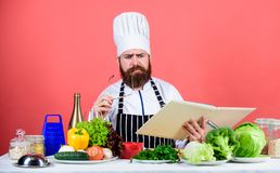Cookery on my mind. Cooking skill. Book recipes. According to recipe. Man bearded chef cooking food. Check if you have. All ingredients. Cook read book recipes royalty free stock photos