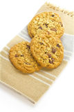 Cookie. Delicious healthy oatmeal raisin cookies presented on a 100 percent cotton napkin stock photos
