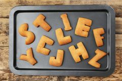 Cookie alphabet on baking tray. Top view stock image
