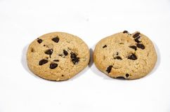 Two chocolate chip cookies  the best foods. A cookie is a baked or cooked food that is small, flat and sweet. It usually contains flour, sugar and some type of Stock Photos