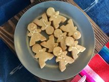 Man shaped cookies in Plate. A cookie is a baked or cooked food that is small, flat and sweet. It usually contains flour, sugar and some type of oil or fat. It royalty free stock photography
