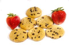 Six sweet fresh chocolate chop cookie and strawberry`s. A cookie is a baked or cooked food that is small, flat and sweet. It usually contains flour, sugar and Royalty Free Stock Photography