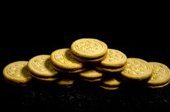 A bid  stack of sweet round cookie`s. A cookie is a baked or cooked food that is small, flat and sweet. It usually contains flour, sugar and some type of oil or Stock Image