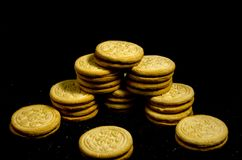 The big stack of sweet round cookie`s. A cookie is a baked or cooked food that is small, flat and sweet. It usually contains flour, sugar and some type of oil or Stock Photo