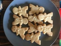 Nine Human shaped cookies in Plate. A cookie is a baked or cooked food that is small, flat and sweet. It usually contains flour, sugar and some type of oil or Stock Photo
