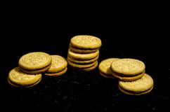 Two small stack`s of sweet round cookie`s. A cookie is a baked or cooked food that is small, flat and sweet. It usually contains flour, sugar and some type of Royalty Free Stock Photography