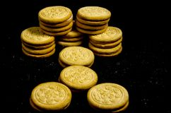 A small stack of sweet round cookie`s. A cookie is a baked or cooked food that is small, flat and sweet. It usually contains flour, sugar and some type of oil or Stock Photos
