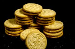 A stack of sweet round of cookie`s. A cookie is a baked or cooked food that is small, flat and sweet. It usually contains flour, sugar and some type of oil or Royalty Free Stock Image