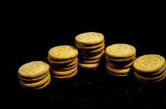 A short big stack of sweet round cookie`s. A cookie is a baked or cooked food that is small, flat and sweet. It usually contains flour, sugar and some type of Stock Photos