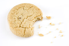 Cookie Bite. Stem ginger cookie with a bite out of it on a white background Stock Photo
