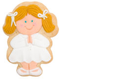 Cookie blonde girl first communion Royalty Free Stock Photos
