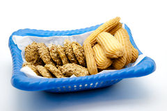 Cookie in the blue basket. And on white background Royalty Free Stock Photo