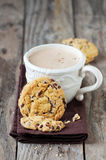 Cookie and cappuccino Stock Images
