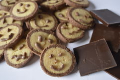 Cookie with chocolate face, with chocolate smile royalty free stock photo