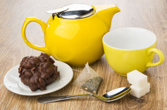 Cookie with chocolate and nuts, teapot, cup, teabag, sugar Stock Images