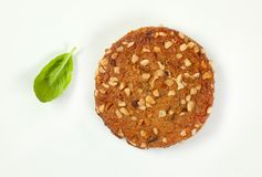 Cookie with chopped nuts and almonds. On white background Royalty Free Stock Image