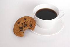 Cookie and coffee. Close-up of cookie and coffee on white background Royalty Free Stock Photos