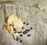 Cookie and coffee beens on sacks background Royalty Free Stock Photos