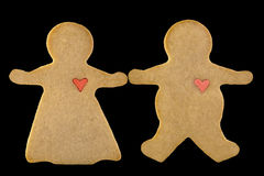 Cookie Couple 1. A pasty white, organic, unbleached cookie couple with heart Stock Photography