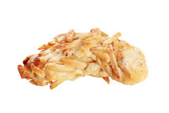 Cookie covered in chopped almonds Royalty Free Stock Images