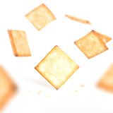 Cookie crackers falling from top Royalty Free Stock Images
