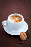 Cookie and cup of coffee. Coffee bean cookie and cup of hot coffee, selective focus Stock Photos
