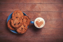 Cookie and cup Stock Images