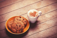 Cookie and cup Stock Photos