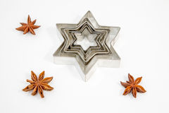 Cookie Cutter and Anis Stars Royalty Free Stock Images