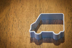 Cookie cutter car. On wood Royalty Free Stock Image